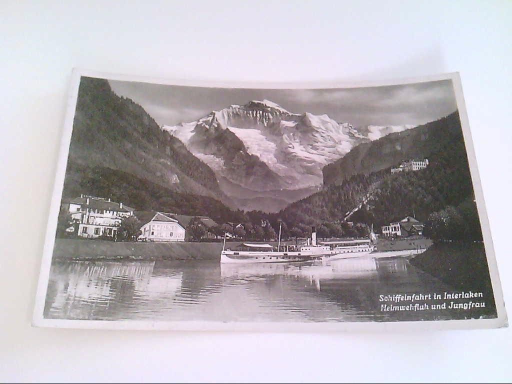 AK. Schiffeinfahrt in Interlaken. Heimwehfluh und Jungfrau.