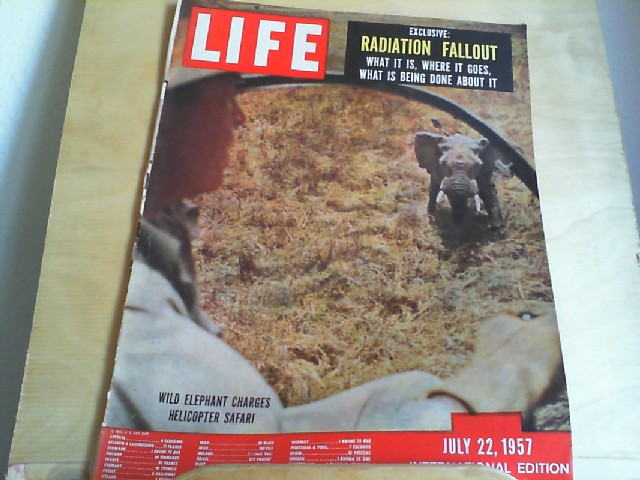 LIFE. International Edition. July 22, 1957. Titlepicture: Wild elephant charges helicopter safari. Titlestory: Exclusive: Radiation Fallout - What it is, where it goes, what is being done about it