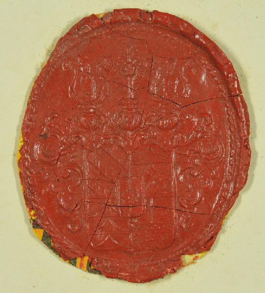 Wappensiegel des Hauses Trautmannsdorf. Wappen viergeteilt mit Schild in der Mitte, darin eine Blume; über den seitlichen Helmen zwei Personendarstellungen, über den mittleren Helm nochmals die Blume. Mit reicher Seitenornamentik.