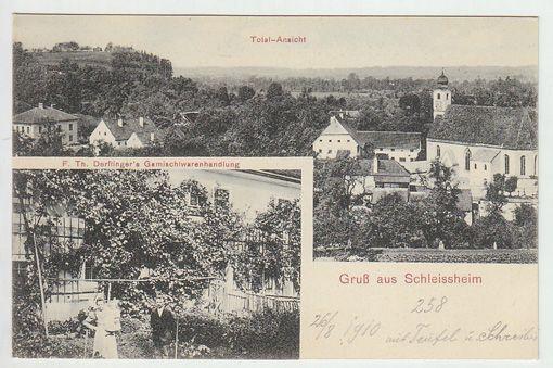 Gruß aus Schleissheim. Totalansicht. F. Th. Derflinger`s Gemischtwarenhandlung.